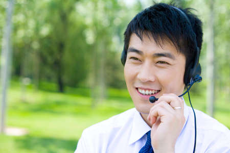 handsfree telephone: Businessman in the grass