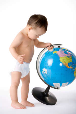 world at your fingertips: Infant with globe LANG_EVOIMAGES