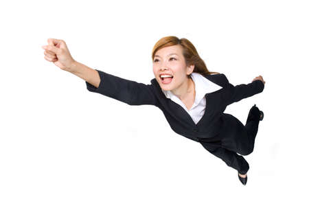 Young businesswoman pumping fist