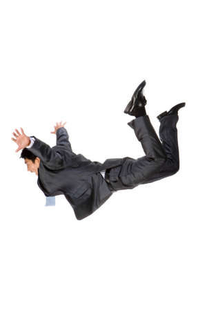 Young businessman falling down from the sky