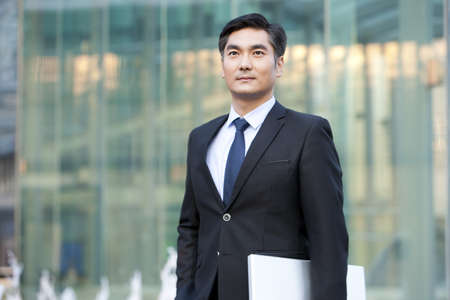 business: Businessman outside office building