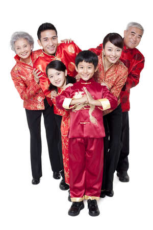 tang: Family Dressed in Traditional Clothing  Celebrating Chinese New Year