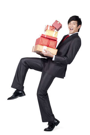 Excited Businessman Holding a Stack of Gifts LANG_EVOIMAGES
