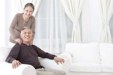 one mature man only: Happy senior couple doing message LANG_EVOIMAGES