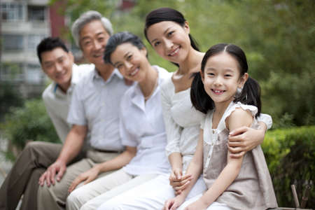 Chinese family with grandparents in a park LANG_EVOIMAGES