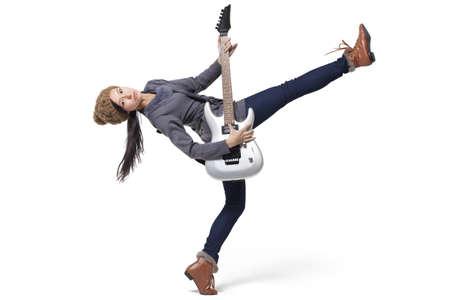 plucking: Stylish young woman playing guitar