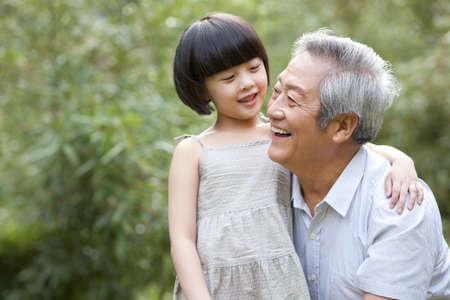 grandaughter: Grandpa and grandaughter having fun in garden