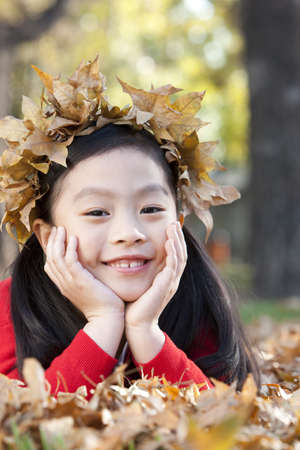 Girl with a crown of Autumn leaves