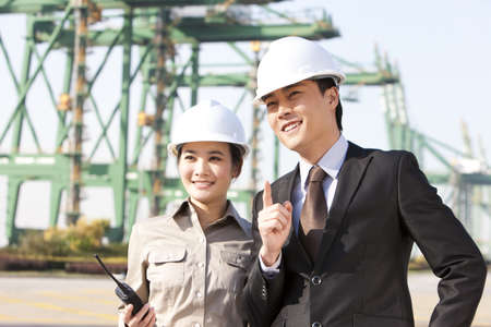 businessman with shipping industry worker in discussion
