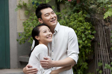 Young Chinese couple embracing