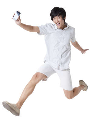 short shorts: Young Man Jumping With a Mobile Phone