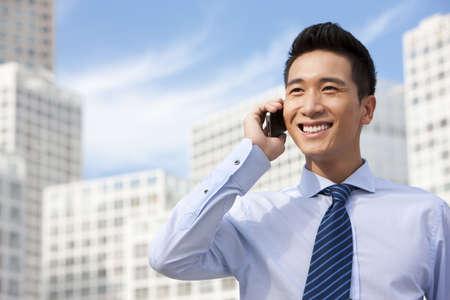 Businessman Using Mobile Phone LANG_EVOIMAGES
