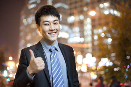 business: Businessman thumbs-up