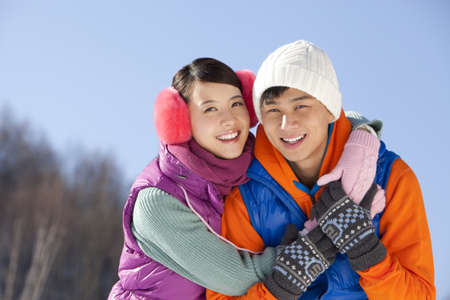 hebei: Happy young couple in ski resort LANG_EVOIMAGES
