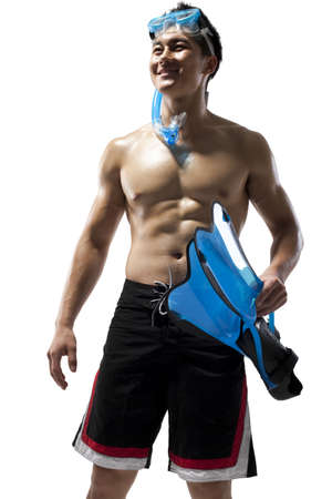 Shirtless muscular man holding swimming gear