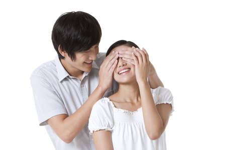 Man Covering Girlfriends Eyes