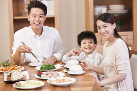 family: Happy family enjoying meal time