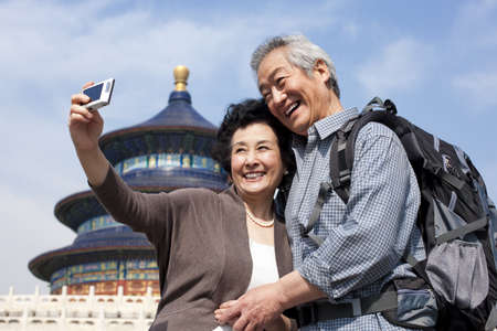 Senior couple travelling at Temple of Heaven in Beijing,China LANG_EVOIMAGES