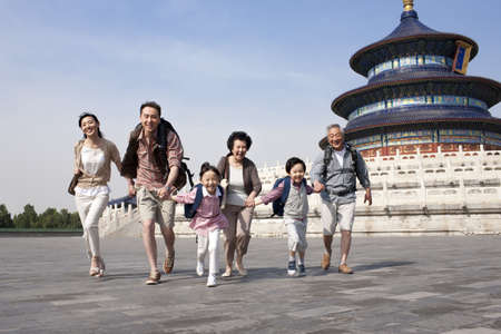 looking for love: Happy family travelling at Temple of Heaven in Beijing,China