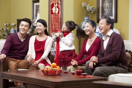 red sofa: Happy family singing karaoke during Chinese New Year