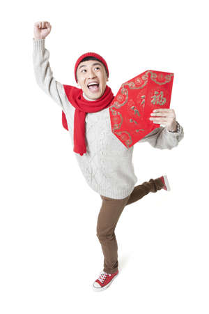 Excited young man enjoying Chinese New Year with red envelops