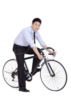 Cheerful young businessman on bike