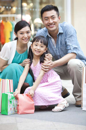 family: Family shopping in department store LANG_EVOIMAGES