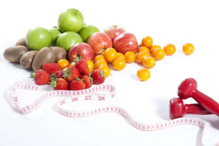 Fruits,measuring tape and dumbbell LANG_EVOIMAGES
