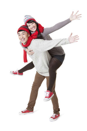 Lovely young couple doing piggyback in Chinese New Year LANG_EVOIMAGES