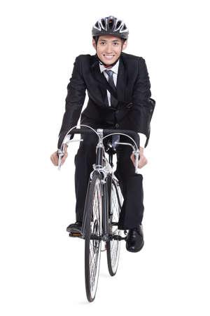 Portrait of young businessman riding a bike LANG_EVOIMAGES