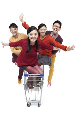 Excited young friends with shopping cart in Chinese New Year LANG_EVOIMAGES