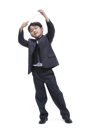 Boy dressing up like a conductor LANG_EVOIMAGES