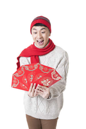 envelops: Excited young man with red envelops for Chinese New Year