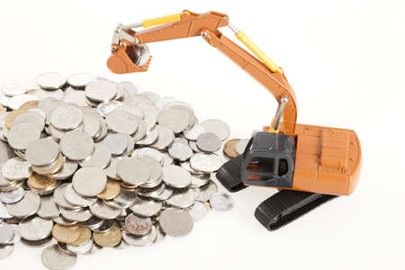 Excavator model and coins LANG_EVOIMAGES