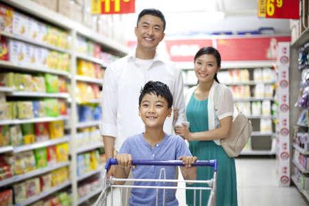Family shopping in supermarket