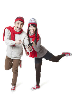 Cheerful young couple with smart phone in Chinese New Year