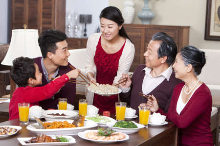 merry family having chinese new year dinner stock photo picture and royalty free image image 75123623 - Chinese New Year Dinner