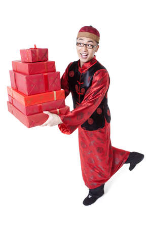 Happy young man in Tang suit holding gift boxes LANG_EVOIMAGES