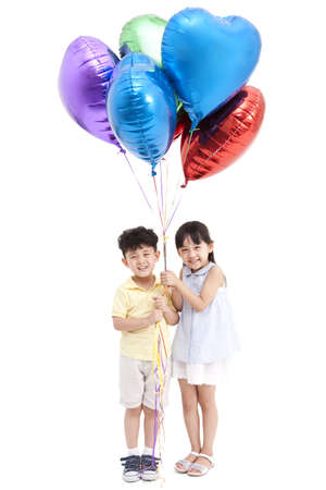 multi age: Joyful children with colorful balloons