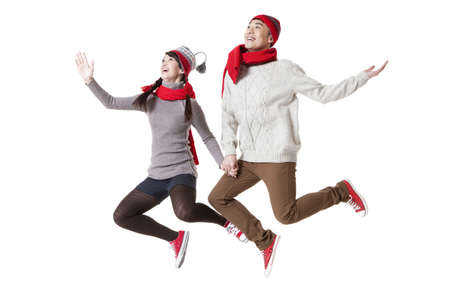 Young couple jumping cheerfully in Chinese New Year