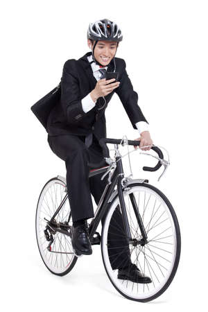 young businessman checking smart phone on bike LANG_EVOIMAGES