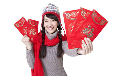 envelops: Young woman with red envelops greeting for Chinese New Year