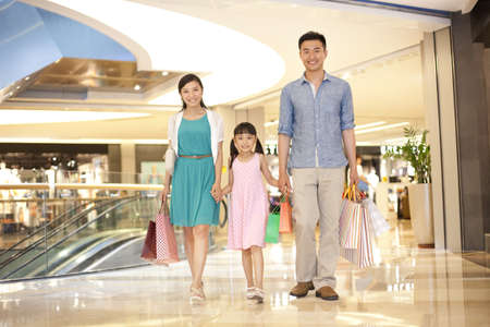 Family shopping in department store LANG_EVOIMAGES