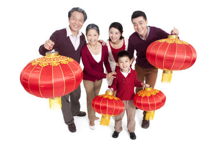 Happy family holding Chinese lantern LANG_EVOIMAGES