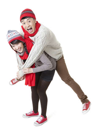 Young couple doing piggyback in Chinese New Year