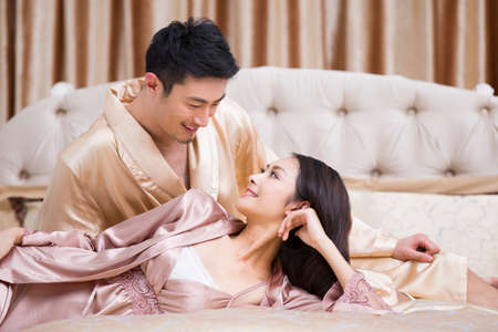Happy young couple in bedroom