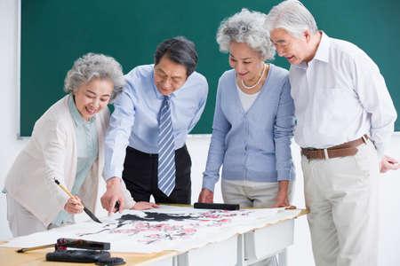 Senior adults having art class at school LANG_EVOIMAGES