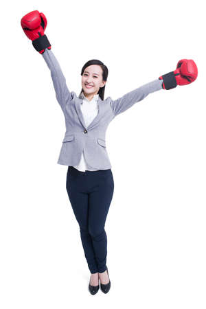 punched out: Businesswoman with boxing gloves celebrating victory