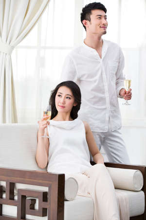 comfort food: Cheerful young couple with champagne