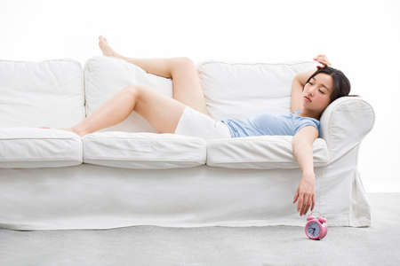 Young woman sleeping on couch